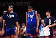 <p>SAITAMA, JAPAN - JULY 25: Kevin Durant #7 and JaVale McGee #11 of Team United States walk off the court after the United States lost to France in the Men's Preliminary Round Group B game on day two of the Tokyo 2020 Olympic Games at Saitama Super Arena on July 25, 2021 in Saitama, Japan. (Photo by Mike Ehrmann/Getty Images)</p>