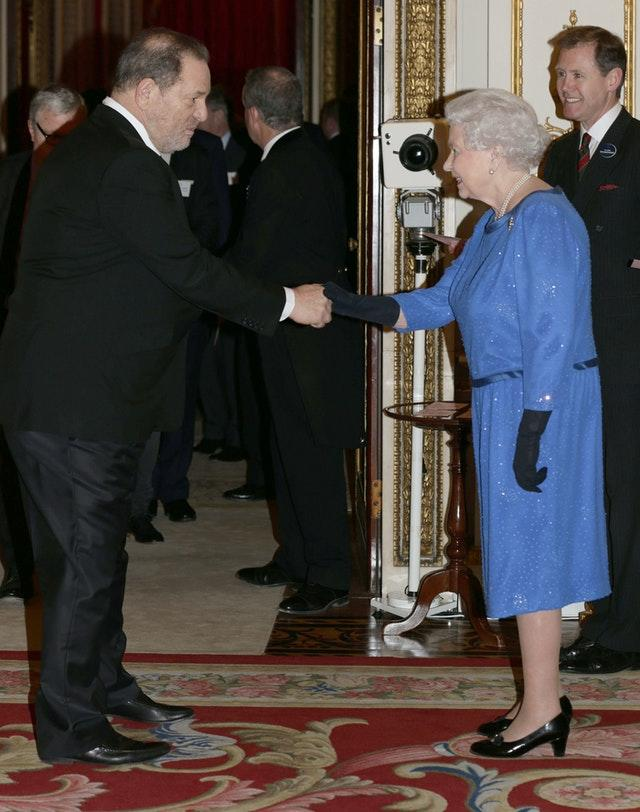The Queen meeting Harvey Weinstein during a reception at Buckingham Palace