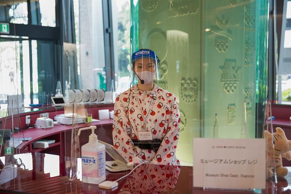 Staff at the Japan Olympic Museum with protective gear as a precaution against the spread of the coronavirus.