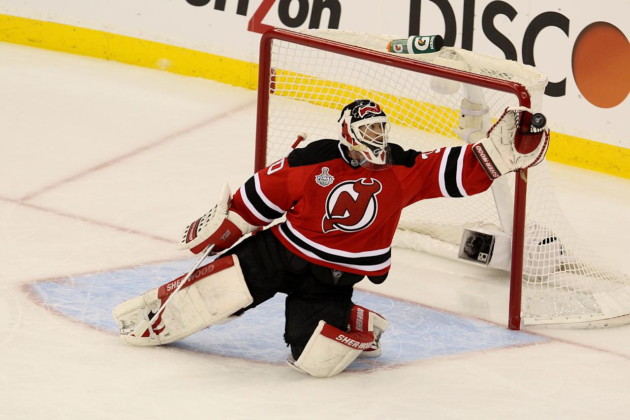 NEWARK, NJ - MAY 30: Martin Brodeur #30 of the New Jersey Devils makes a save against the Los Angeles Kings during Game One of the 2012 NHL Stanley Cup Final at the Prudential Center on May 30, 2012 in Newark, New Jersey.  (Photo by Jim McIsaac/Getty Images)