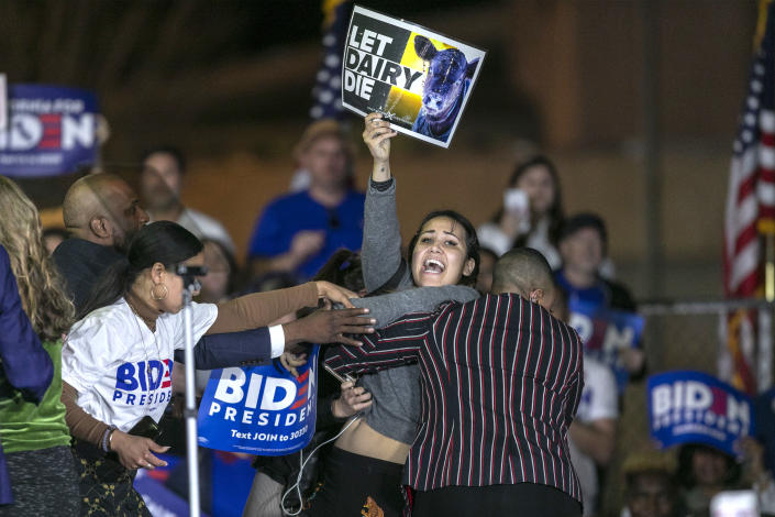 """A woman charges the stage while holding a sign that reads """"Let Dairy Die"""" during Democratic presidential candidate Joe Biden's Super Tuesday speech in Los Angeles. (David McNew/Getty Images)"""