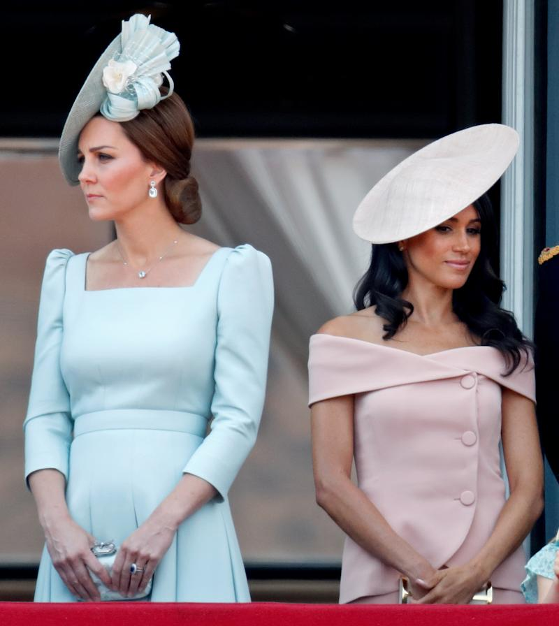 Catherine, Duchess of Cambridge and Meghan, Duchess of Sussex stand on the balcony of Buckingham Palace during Trooping The Colour 2018 on June 9, 2018 in London, England. The annual ceremony involving over 1400 guardsmen and cavalry, is believed to have first been performed during the reign of King Charles II. The parade marks the official birthday of the Sovereign, even though the Queen's actual birthday is on April 21st.