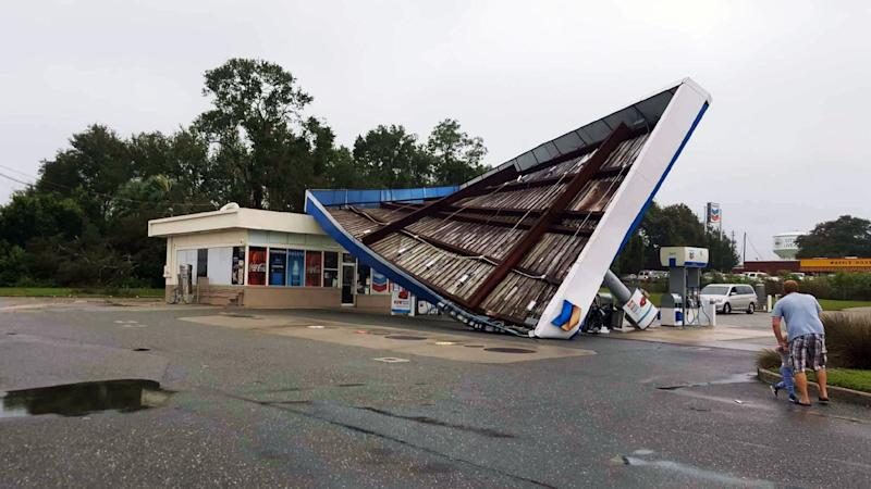 A damaged Chevron station in the city of Live Oak, Florida. (David Lohr/HuffPost)