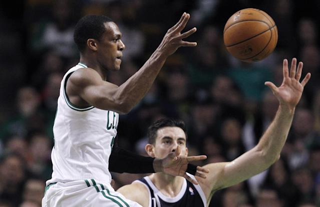 Boston Celtics guard Rajon Rondo passes the ball as he is pressured by Oklahoma City Thunder forward Nick Collison during the second half of an NBA basketball game in Boston, Friday, Jan. 24, 2014. Rondo was held to five points as the Thunder defeated the Celtics 101-83. (AP Photo/Charles Krupa)