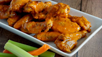 """<p>It's straight-up unAmerican to watch any heated competition without some Buffalo wings. Rather than ordering in from one of the <a href=""""https://www.thedailymeal.com/eat/americas-best-buffalo-wings-gallery?referrer=yahoo&category=beauty_food&include_utm=1&utm_medium=referral&utm_source=yahoo&utm_campaign=feed"""" rel=""""nofollow noopener"""" target=""""_blank"""" data-ylk=""""slk:best wing joints in the country"""" class=""""link rapid-noclick-resp"""">best wing joints in the country</a>, learn to make them yourself with this easy recipe.</p> <p><a href=""""https://www.thedailymeal.com/recipes/freezer-friendly-chicken-wings-recipe?referrer=yahoo&category=beauty_food&include_utm=1&utm_medium=referral&utm_source=yahoo&utm_campaign=feed"""" rel=""""nofollow noopener"""" target=""""_blank"""" data-ylk=""""slk:For the Buffalo Wings recipe, click here."""" class=""""link rapid-noclick-resp"""">For the Buffalo Wings recipe, click here.</a></p>"""