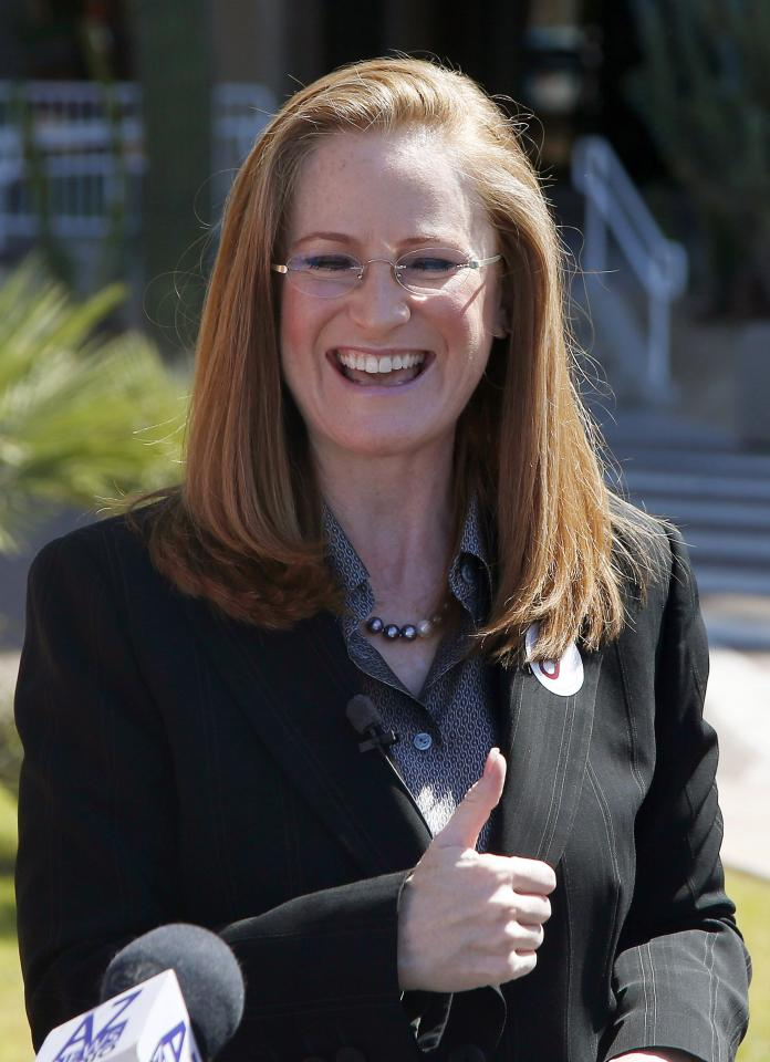 "Christine Jones, a former legal counsel for the website hosting company GoDaddy, gives a thumbs up after she filed her nominating petitions to enter the Republican primary for Arizona governor for the August primary on Monday, April 28, 2014, in Phoenix. Jones is running without public funding and called herself an ""unapologetic conservative"" who will fight for gun rights, border security, and to eliminate federal intrusion into school policy. (AP Photo/Ross D. Franklin)"
