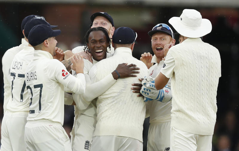 England's Jofra Archer, centre, celebrates after taking the wicket of Australia's Cameron Bancroft lbw on day three of the 2nd Ashes Test cricket match between England and Australia at Lord's cricket ground in London, Friday, Aug. 16, 2019. (AP Photo/Alastair Grant)