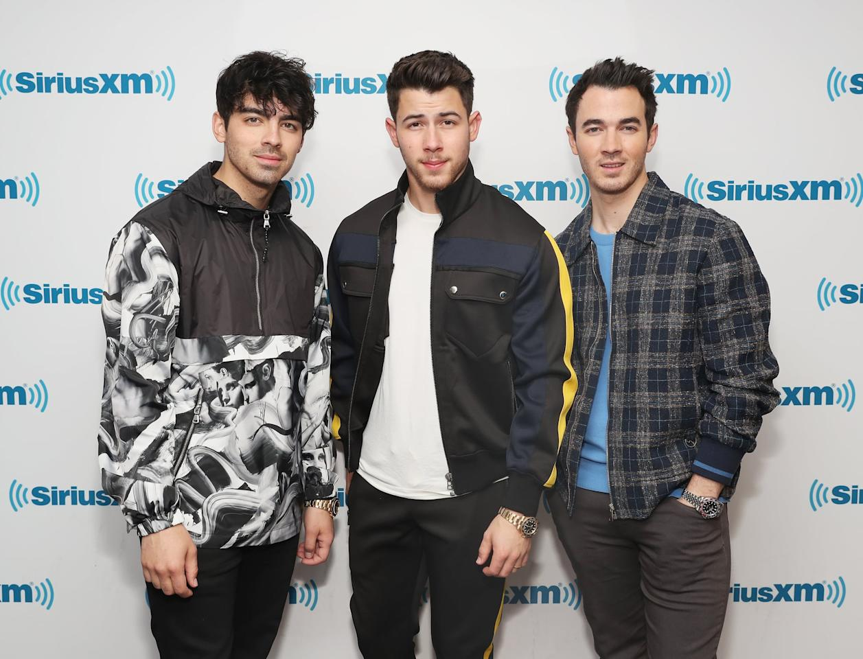 """<p>After <a href=""""https://www.popsugar.com/celebrity/Jonas-Brothers-Reuniting-44502570"""" class=""""ga-track"""" data-ga-category=""""Related"""" data-ga-label=""""http://www.popsugar.com/celebrity/Jonas-Brothers-Reuniting-44502570"""" data-ga-action=""""In-Line Links"""">announcing their reunion</a>, the brothers appeared on a handful of radio shows to talk about their new music. Around the same time, they also revealed that <a href=""""https://www.popsugar.com/entertainment/Jonas-Brothers-Chasing-Happiness-Amazon-Documentary-Trailer-46137644"""" class=""""ga-track"""" data-ga-category=""""Related"""" data-ga-label=""""http://www.popsugar.com/entertainment/Jonas-Brothers-Chasing-Happiness-Amazon-Documentary-Trailer-46137644"""" data-ga-action=""""In-Line Links"""">they were releasing an Amazon documentary</a> called <a href=""""https://www.popsugar.com/latest/Chasing-Happiness"""" class=""""ga-track"""" data-ga-category=""""Related"""" data-ga-label=""""http://www.popsugar.com/latest/Chasing-Happiness"""" data-ga-action=""""In-Line Links""""><strong>Chasing Happiness</strong></a>. </p>"""