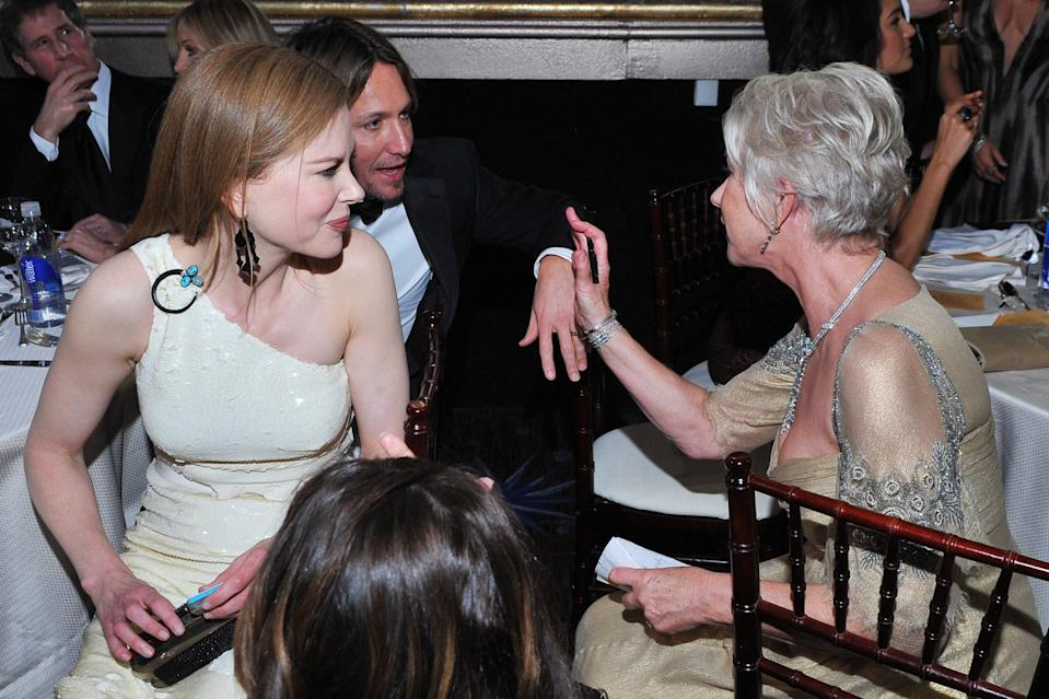 <p>Helen Mirren engages in an animated discussion with Keith Urban and Nicole Kidman. (We assume she's telling him she's a monster fan of country music.)</p>
