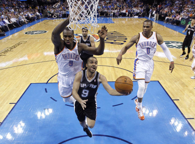 San Antonio Spurs guard Tony Parker (9) goes up for a shot in front of Oklahoma City Thunder forward Serge Ibaka (9) and guard Russell Westbrook (0) during the second quarter of an NBA basketball game in Oklahoma City, Thursday, April 3, 2014. Oklahoma City won 106-94. (AP Photo/Sue Ogrocki)