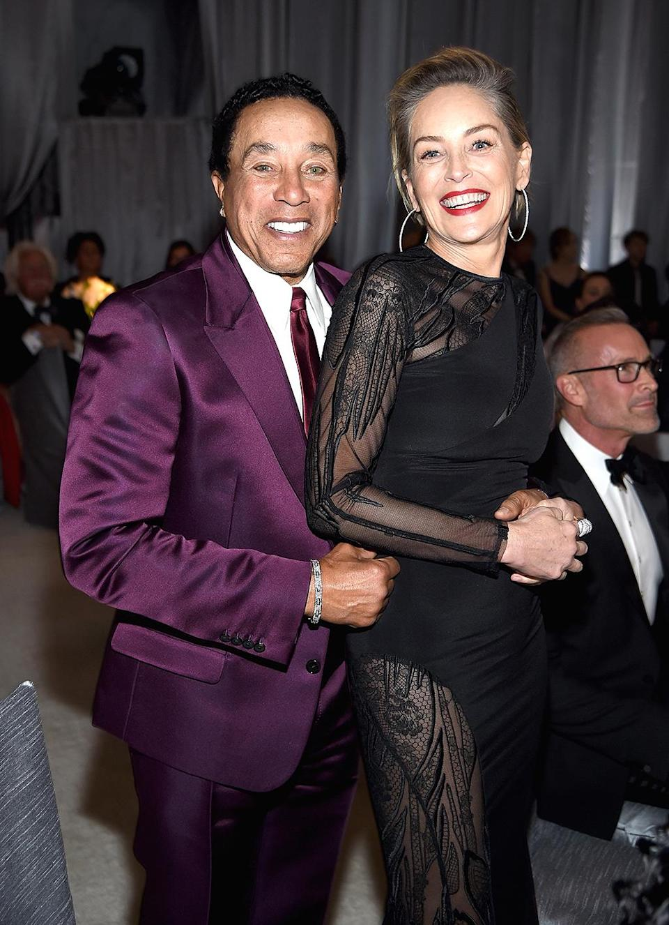 <p>Smokey Robinson and actor Sharon Stone attend the 25th Annual Elton John AIDS Foundation's Academy Awards Viewing Party at The City of West Hollywood Park on February 26, 2017 in West Hollywood, California. (Photo by Dimitrios Kambouris/Getty Images for EJAF) </p>