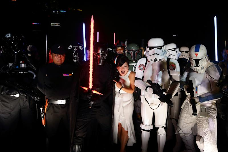 SINGAPORE - NOVEMBER 25: Kelly Marie Tran (C) who plays the part of Rose Tico, a member of the resistance in the upcoming Star Wars: The Last Jedi pose for a photo with the Star Wars characters during the Marina Bay Sands Festive Light-Up - Star Wars:The Last Jedi Edition at Marina Bay Sands on November 25, 2017 in Singapore. Marina Bay Sands and Disney create a special light and water show ahead of Star Wars: The Last Jedi premiere to ring in the festive season. (Photo by Suhaimi Abdullah/Getty Images)