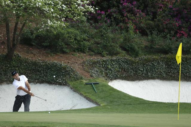 Patrick Reed of the U.S. hits from a sand trap on the 12th hole during second round play of the 2018 Masters golf tournament at the Augusta National Golf Club in Augusta, Georgia, U.S., April 6, 2018. REUTERS/Jonathan Ernst