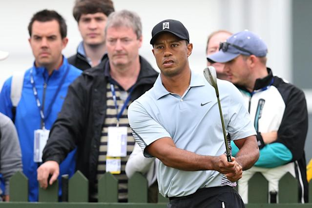 Tiger Woods of the US watches his shot on the practice chipping green ahead of the British Open Golf championship at the Royal Liverpool golf club, Hoylake, England, Wednesday July 16, 2014. The British Open Golf championship starts Thursday July 17. (AP Photo/Scott Heppell)