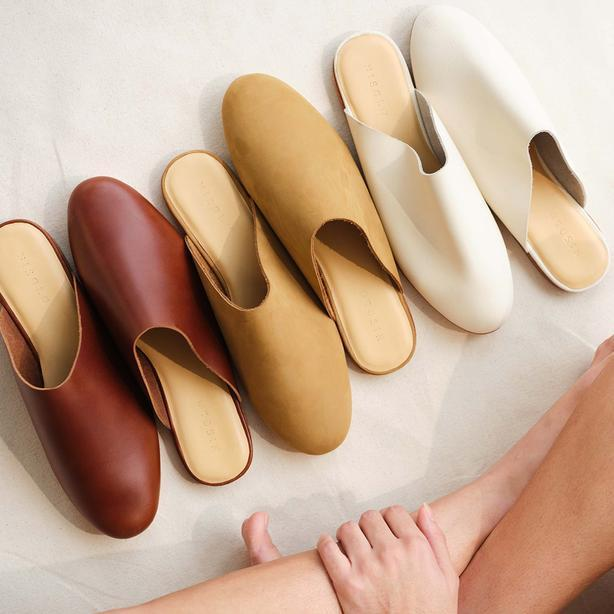 """<h2>Nisolo</h2><br>This footwear and leather goods brand has earned a stellar reputation for its ethical manufacturing practices — and B Corp certification, to boot. (Get it?) At their proprietary factory in Peru — a country where the tradition of shoemaking goes back generations — their producers have experience da 47% increase in earning, and 100% now have a bank account.<br><br><em>Shop <strong><a href=""""https://nisolo.com/pages/ethically-made"""" rel=""""nofollow noopener"""" target=""""_blank"""" data-ylk=""""slk:Nisolo"""" class=""""link rapid-noclick-resp"""">Nisolo</a></strong></em><br><br><strong>Nisolo</strong> Lima Slip On, $, available at <a href=""""https://go.skimresources.com/?id=30283X879131&url=https%3A%2F%2Fnisolo.com%2Fcollections%2Fwomens-shoes-and-accessories%2Fproducts%2Fwomens-leather-slip-on-sand"""" rel=""""nofollow noopener"""" target=""""_blank"""" data-ylk=""""slk:Nisolo"""" class=""""link rapid-noclick-resp"""">Nisolo</a>"""