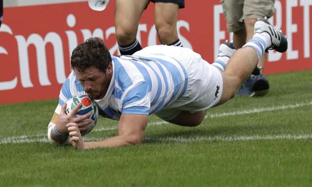 Argentina's Julián Montoya dives across the line to score his team's first try during the Rugby World Cup Pool C game at Hanazono Rugby Stadium between Tonga and Argentina in Osaka, Japan, Saturday, Sept. 28, 2019. (AP Photo/Aaron Favila)