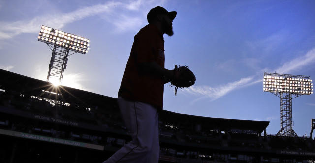 Boston Red Sox starting pitcher David Price heads to the bullpen to warm up before the team's baseball game against the Los Angeles Angels at Fenway Park in Boston, Tuesday, June 26, 2018. (AP Photo/Charles Krupa)