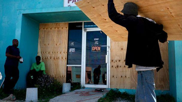 PHOTO: Workers board up a shop window front as they make preparations for the arrival of Hurricane Dorian, in Freeport, Bahamas, Friday, Aug. 30, 2019. (Ramon Espinosa/AP Photo)