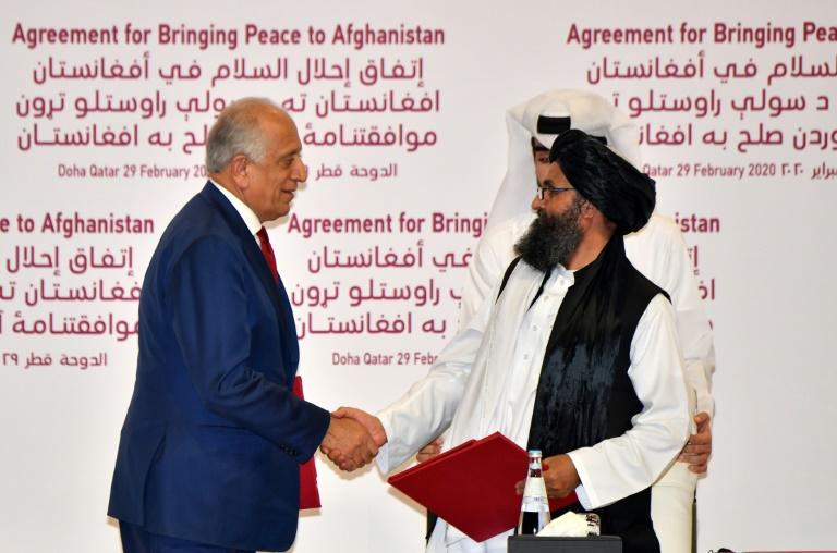 The agreement signed by US negotiator Zalmay Khalilzad (L) and the Taliban's Mullah Baradar was meant to set the conditions for a complete withdrawal of foreign forces from Afghanistan within just 14 months -- and end the longest war in US history (AFP Photo/Giuseppe CACACE)