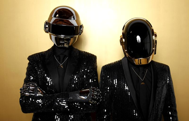 """FILE - In this April 17, 2013 file photo, Thomas Bangalter, left, and Guy-Manuel de Homem-Christo, from the group Daft Punk pose for a portrait in Los Angeles. Daft Punk's single """"Get Lucky"""" is one of the top songs of the summer. (Photo by Matt Sayles/Invision/AP, File)"""