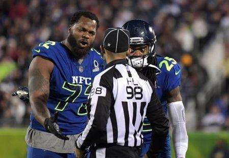 FILE PHOTO: Jan 29, 2017; Orlando, FL, USA; NFC defensive end Michael Bennett (72) and cornerback Richard Sherman (25) of the Seattle Seahawks react to a call by head linesman Greg Bradley (99) during the 2017 Pro Bowl at Camping World Stadium. Kirby Lee-USA TODAY Sports