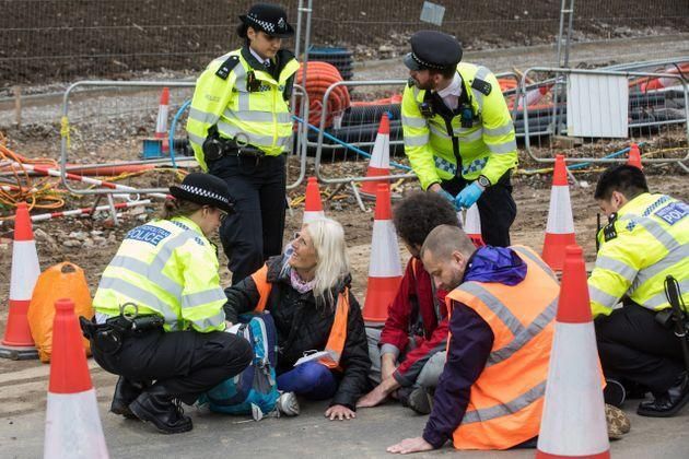 Insulate Britain climate activists pictured glued onto a slip road from the M25 (Photo: Mark Kerrison via Getty Images)