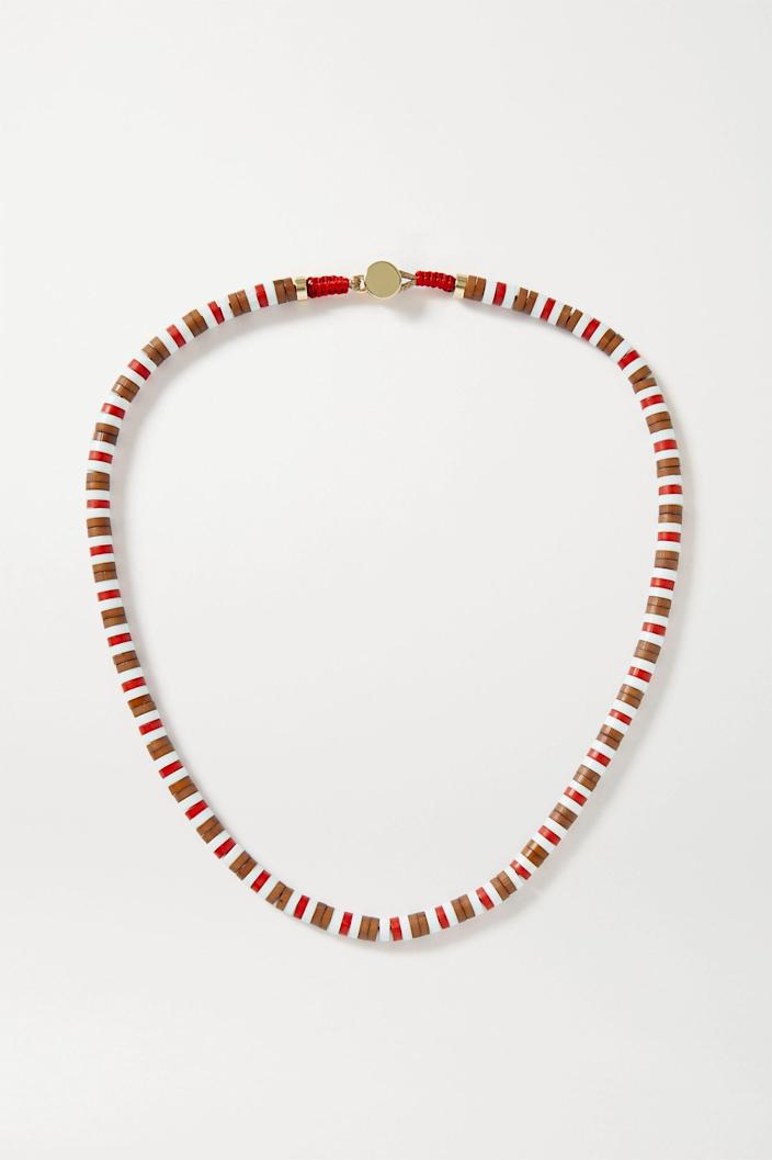 """This beaded necklace is a great transition piece from your kitschy summer jewelry to more put-together fall styles. <br> <br> <strong>Roxanne Assoulin</strong> U-Tube Wood Necklace, $, available at <a href=""""https://go.skimresources.com/?id=30283X879131&url=https%3A%2F%2Fwww.net-a-porter.com%2Fen-us%2Fshop%2Fproduct%2Froxanne-assoulin%2Fu-tube-wood-necklace%2F1277493"""" rel=""""nofollow noopener"""" target=""""_blank"""" data-ylk=""""slk:Net-A-Porter"""" class=""""link rapid-noclick-resp"""">Net-A-Porter</a>"""