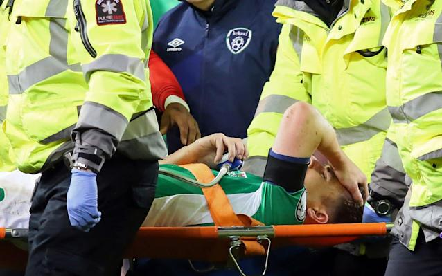 Seamus Coleman is stretchered off - AFP