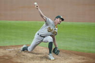 Oakland Athletics starting pitcher Chris Bassitt throws a pitch in the first inning against the Texas Rangers in the first inning in a baseball game Thursday, June 24, 2021, in Arlington, Texas. (AP Photo/Louis DeLuca)