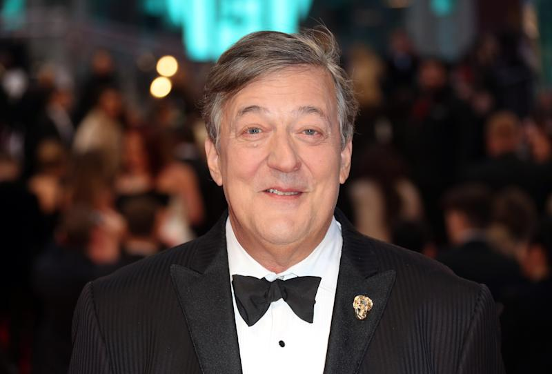 Stephen Fry poses for photographers upon arrival at the British Academy Film Awards in London, Sunday, Feb. 12, 2017. (Photo by Joel Ryan/Invision/AP)