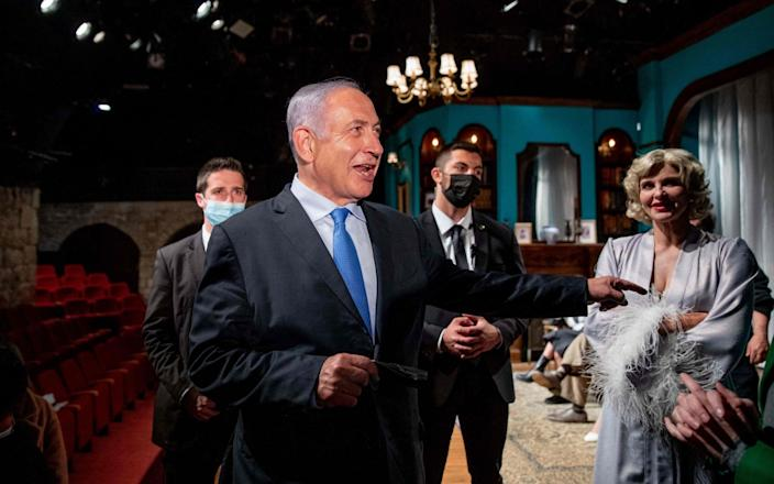 Israeli Prime Minister Benjamin Netanyahu visits a theatre in Jerusalem to mark the re-opening of the culture sector amid a highly successful vaccination programme - OHAD ZWIGENBERG/AFP
