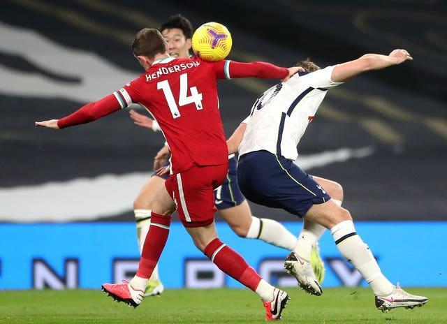 Liverpool captain Jordan Henderson tackles Tottenham striker Harry Kane