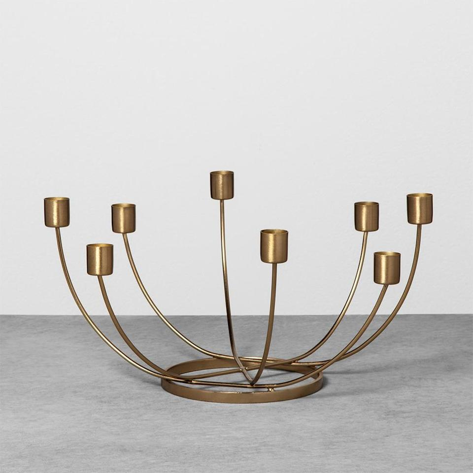 "<p>Whether this brass beauty ends up on the dining table or coffee table, it will light up the room. The 8-candle centerpiece is a decorative must-have that can be used year-round.<br><strong><a href=""https://fave.co/2PWzOZX"" rel=""nofollow noopener"" target=""_blank"" data-ylk=""slk:SHOP IT"" class=""link rapid-noclick-resp"">SHOP IT</a>:</strong> $13 (on sale, $9),<a href=""https://fave.co/2PWzOZX"" rel=""nofollow noopener"" target=""_blank"" data-ylk=""slk:target.com"" class=""link rapid-noclick-resp""> target.com</a> </p>"