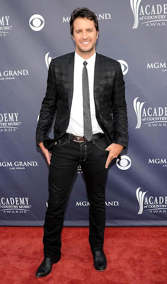 """Luke Bryan  Grade: B-   Luke Bryan took a fashion risk by pairing his black jeans with a funky patterned black blazer. Do you think it was a hit ... or a miss? Rick Diamond/<a href=""""http://www.gettyimages.com/"""" target=""""new"""">GettyImages.com</a> - April 3, 2011"""