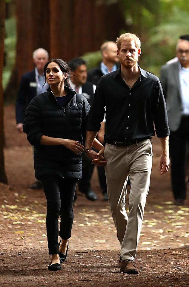 <p>The Duchess of Sussex changed into a less formal outfit for the couple's final day of the royal tour. Meghan wore her go-to Mother jeans, flat pumps and a Norrøna coat for a visit to the Redwoods Treewalk on October 31. <em>[Photo: Getty]</em> </p>