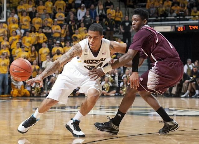Missouri's Jabari Brown, left, has the ball knocked away by Mississippi State's Fred Thomas, right, during the first half of an NCAA college basketball game Saturday, March 1, 2014, in Columbia, Mo. (AP Photo/L.G. Patterson)