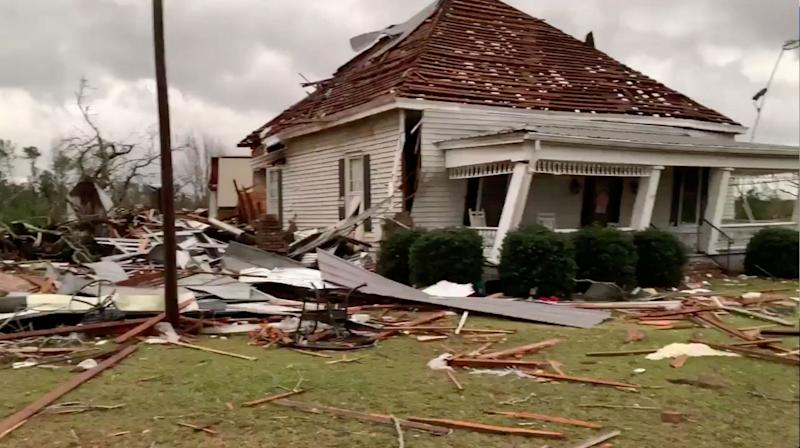 Debris and a damaged house seen following a tornado in Beauregard, Alabama, U.S. in this March 3, 2019 still image obtained from social media video. (Photo: Scott Fillmer /via Reuters)