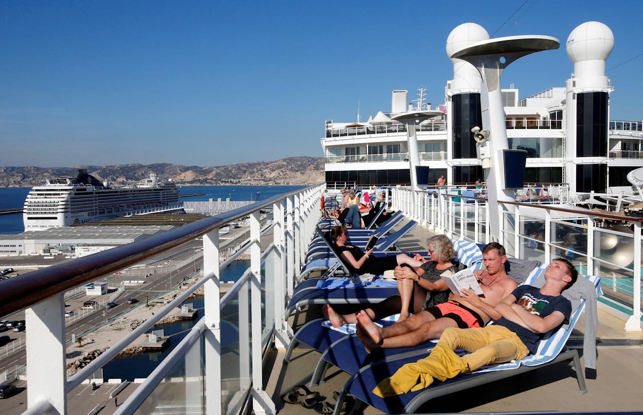 People relax on the sundeck of Norwegian Epic cruise ship moored at the cruise terminal in Marseille, France, October 22, 2016.     REUTERS/Jean-Paul Pelissier