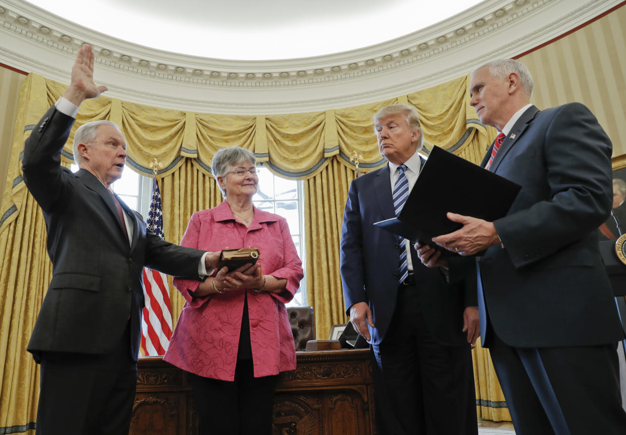 President Trump watches as Vice President Mike Pence swears in Jeff Sessions as attorney general on Feb. 9, 2017, as Sessions's wife, Mary, watches. (Photo: Pablo Martinez Monsivais/AP)