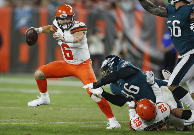 Cleveland Browns quarterback Baker Mayfield scrambles during the first half of an NFL preseason football game against the Philadelphia Eagles, Thursday, Aug. 23, 2018, in Cleveland. (AP Photo/Ron Schwane)