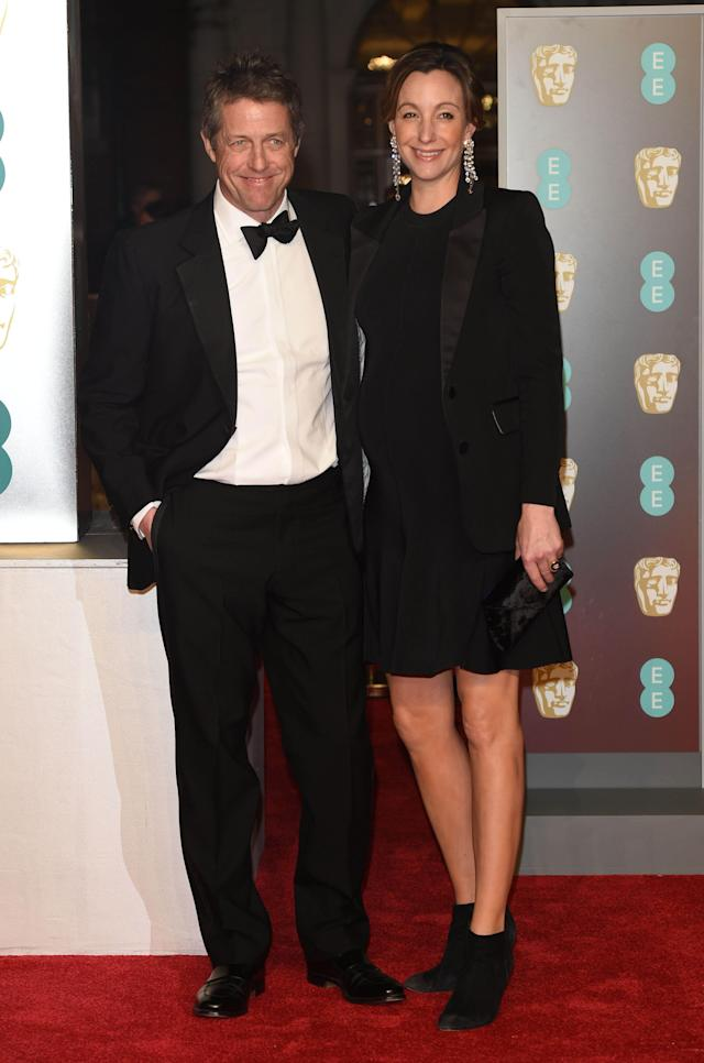 Hugh Grant and Anna Eberstein have made a few red carpet appearances, including one at the <span>71st British Academy Film Awards on Feb. 18, 2018. (Photo: AP Images)</span>