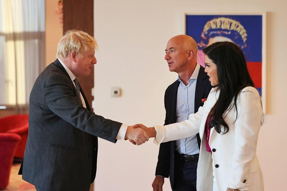 Prime Minister Boris Johnson greets Amazon founder Jeff Bezos and his girlfriend, Lauren Sanchez, at the UK diplomatic residence (PA)