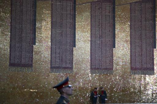 In this Sunday, June 17, 2018 photo, Russian soldiers stand at the Hall of Military Glory in Volgograd, Russia. Nearly 60 years since it changed its name to Volgograd, the Russian city once called Stalingrad and its bloody history loom large even in the midst of the fun and football of the World Cup. (AP Photo/Thanassis Stavrakis)
