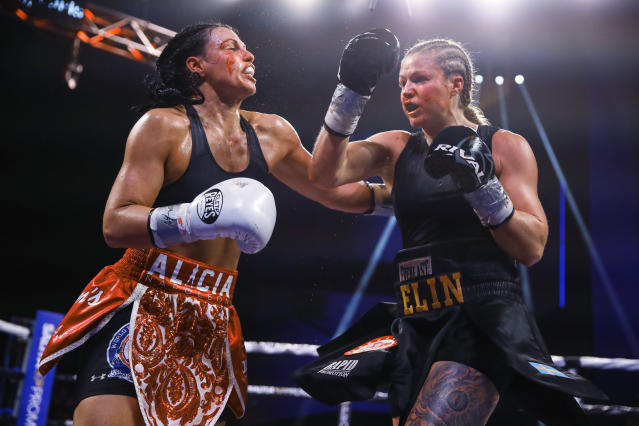Alicia Napoleon-Espinosa, left, and Elin Cederroos trade punches during the 10th round of their boxing bout in Atlantic City, N.J., Friday, Jan. 10, 2020. (AP Photo/Matt Rourke)