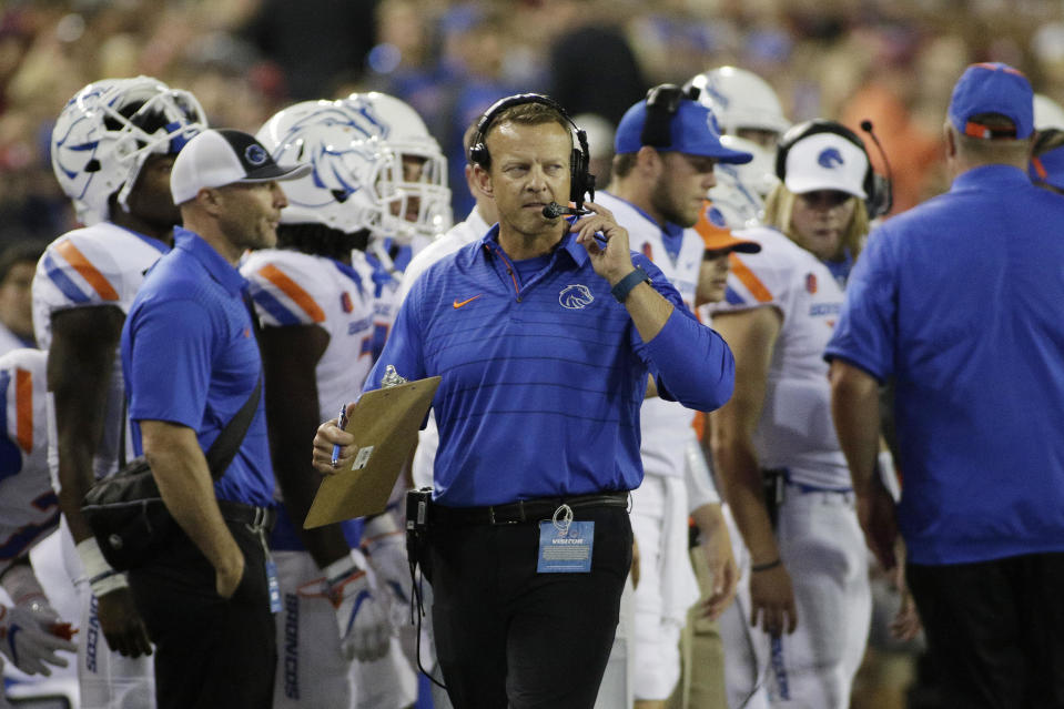 Boise State head coach Bryan Harsin walks on the sideline during the first half of an NCAA college football game against Washington State in Pullman, Wash., Saturday, Sept. 9, 2017. (AP Photo/Young Kwak)