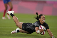 New Zealand's Stacey Fluhler dives to score a try, in the women's rugby gold medal match between New Zealand and France at the 2020 Summer Olympics, Saturday, July 31, 2021 in Tokyo, Japan. (AP Photo/Shuji Kajiyama)