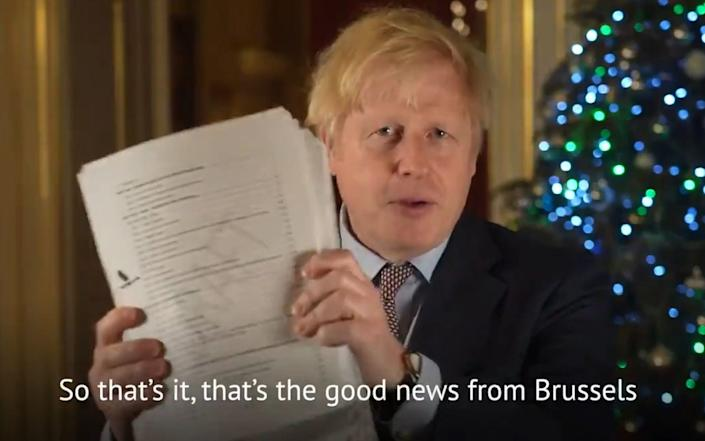 Boris Johnson with the deal document during a Christmas messaged posted on Twitter