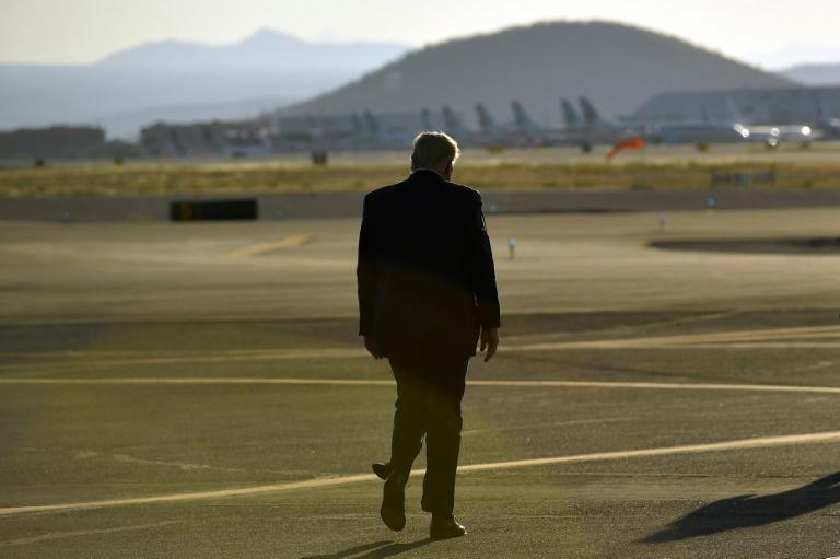 US President Donald Trump departs after a rally at Tucson International Airport in Tucson, Arizona on October 19, 2020