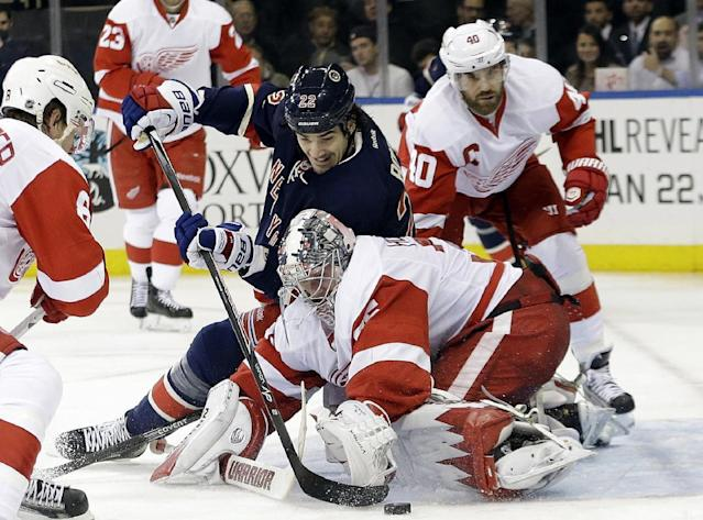 New York Rangers' Brian Boyle (22) and Detroit Red Wings goalie Jimmy Howard (35) fight for control of the puck as Henrik Zetterberg (40) watches during the second period of an NHL hockey game, Thursday, Jan. 16, 2014, in New York. (AP Photo/Frank Franklin II)
