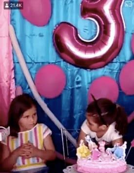 Sisters Fighting Over Blowing Out Birthday Candle